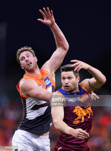 Dawson Simpson of the Giants competes for the ball against Stefan Martin of the Lions during the round 16 AFL match between the Greater Western...