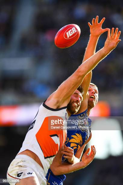 Dawson Simpson of the Giants contests a boundary throw in against Nathan Vardy of the Eagles during the 2018 AFL round 16 match between the West...