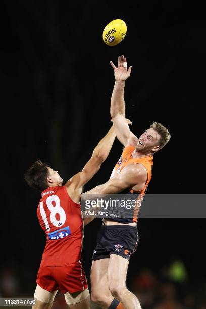 Dawson Simpson of the Giants is challenged by Callum Sinclair of the Swans during the 2019 JLT Community Series AFL match between the Greater Western...