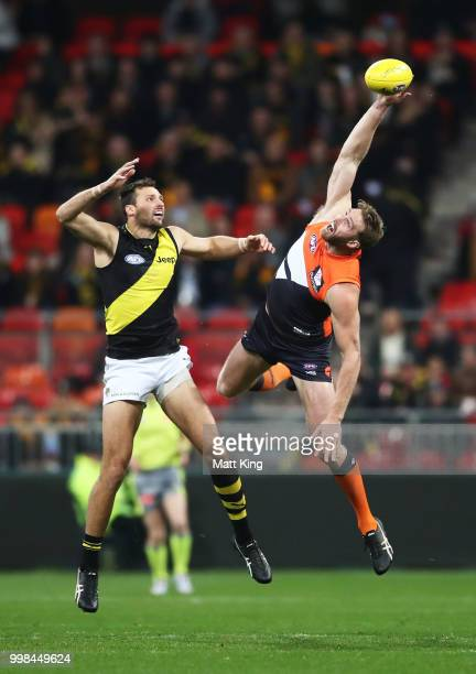 Dawson Simpson of the Giants is challenged by Toby Nankervis of the Tigers during the round 17 AFL match between the Greater Western Sydney Giants...