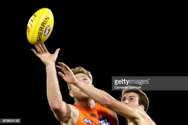 Dawson Simpson of the Giants taps the ball during the JLT Community Series AFL match between the Sydney Swans and the Greater Western Sydney Giants...