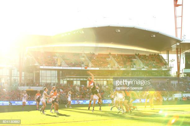 Dawson Simpson of the Giants taps the ball during the round 19 AFL match between the Greater Western Sydney Giants and the Fremantle Dockers at...