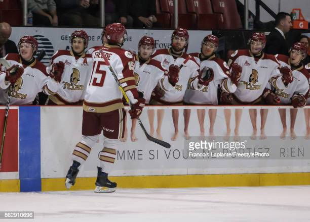 Dawson Theede of the Acadie-Bathurst Titan celebrates his first goal of the first period at the bench with teammates against the Gatineau Olympiques...