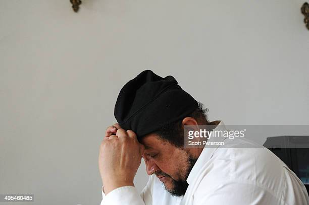 Dawud Salahuddin, an African-American convert to Islam who was born David Theodore Belfield , adjust his hat while posing for a portrait on March 16...