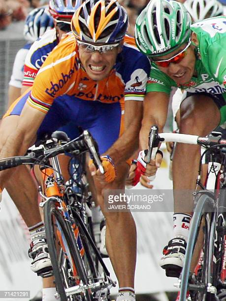 Australia's Robbie McEwen and Spain's Oscar Freire sprint towards the finish line of the 1695 km ninth stage of the 93rd Tour de France cycling race...