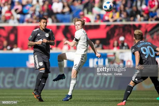 Dax McCarty of Chicago Fire challenged by Alejandro Romero Gamarra of New York Red Bulls and Marc Rzatkowski of New York Red Bulls during the New...