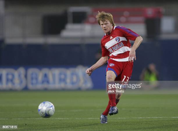 Dax McCarty of FC Dallas kick the ball down field during the match with New England on April 24 2008 at Pizza Hut park in Frisco Texas New England...
