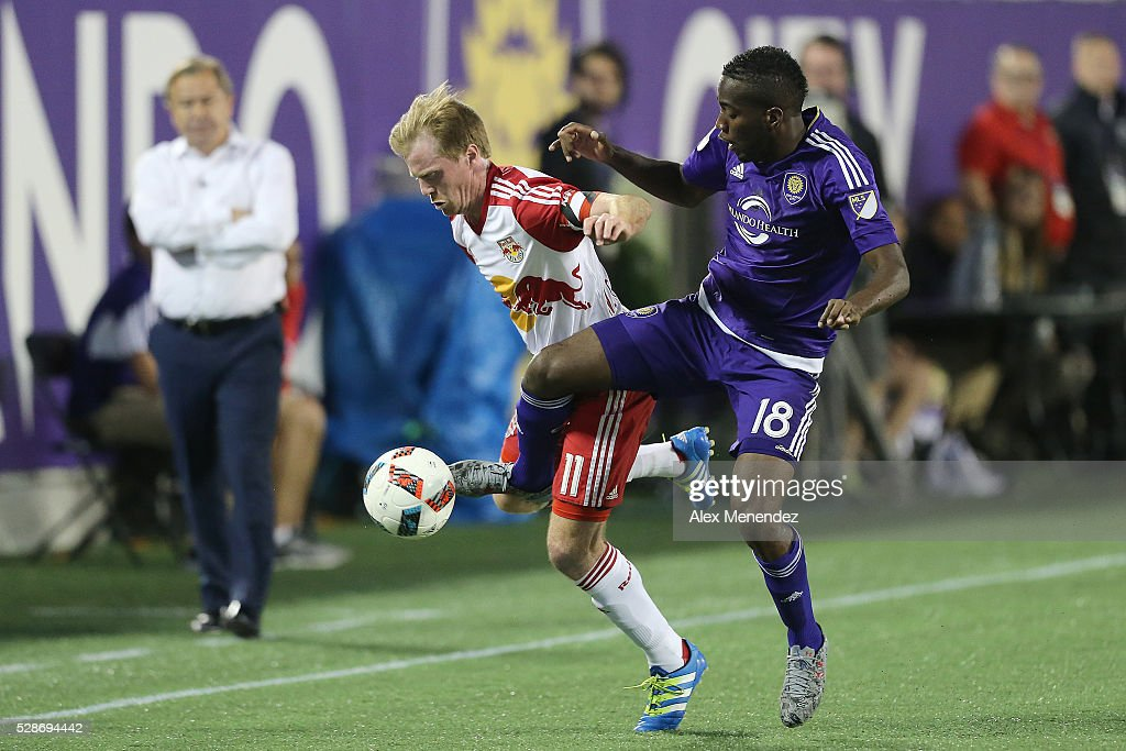 Dax McCarty #11 of New York Red Bulls and Kevin Molino #18 of Orlando City SC fight for the ball during an MLS soccer match at Camping World Stadium on May 6, 2016 in Orlando, Florida. The game ended in a 1-1 draw.