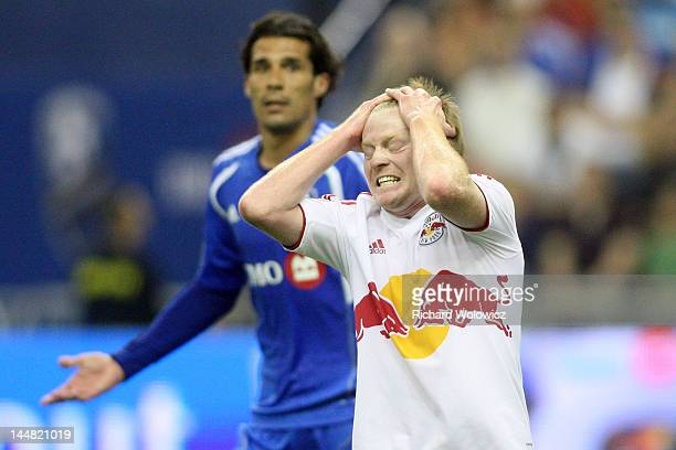 Dax McCarty of the New York Red Bulls reacts after missing an attempt during the MLS match against the Montreal Impact at the Olympic Stadium on May...