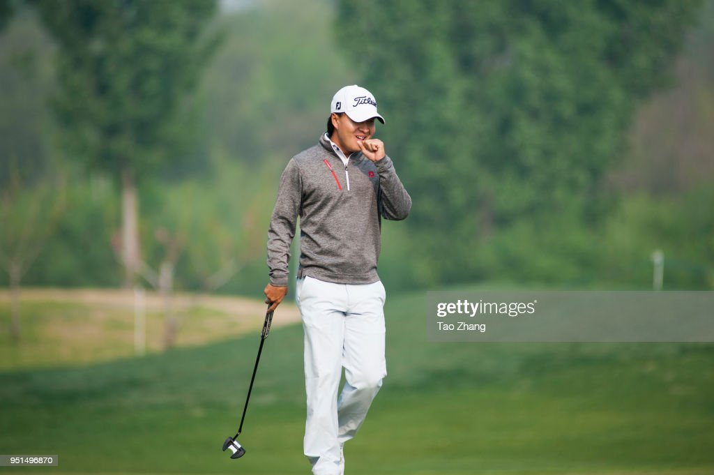 Daxing Jin of China reacts during the first round of the 2018 Volvo China open at Beijing Huairou Topwin Golf and Country Clubon April 26, 2018 in Beijing, China.