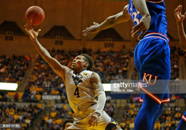 Daxter Miles Jr #4 of the West Virginia Mountaineers drives to the rim against the Kansas Jayhawks at the WVU Coliseum on January 15 2018 in...