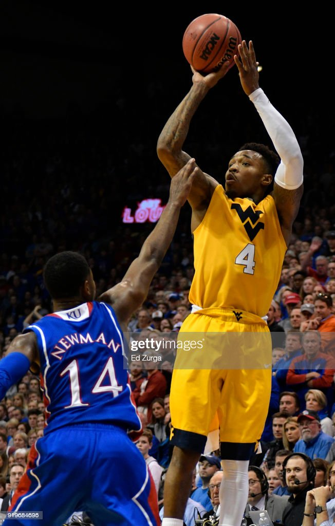 Daxter Miles Jr. #4 of the West Virginia Mountaineers shoots against Malik Newman #14 of the Kansas Jayhawks in the second half at Allen Fieldhouse on February 17, 2018 in Lawrence, Kansas.