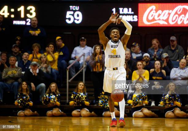 Daxter Miles Jr #4 of the West Virginia Mountaineers signals against the TCU Horned Frogs at the WVU Coliseum on February 12 2018 in Morgantown West...