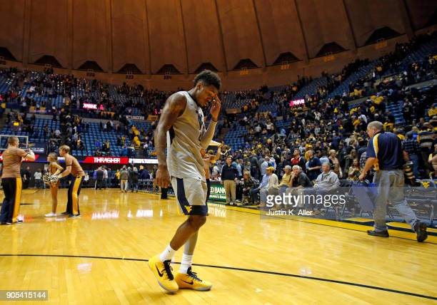 Daxter Miles Jr #4 of the West Virginia Mountaineers walks off the court after losing to Kansas 7166 at the WVU Coliseum on January 15 2018 in...
