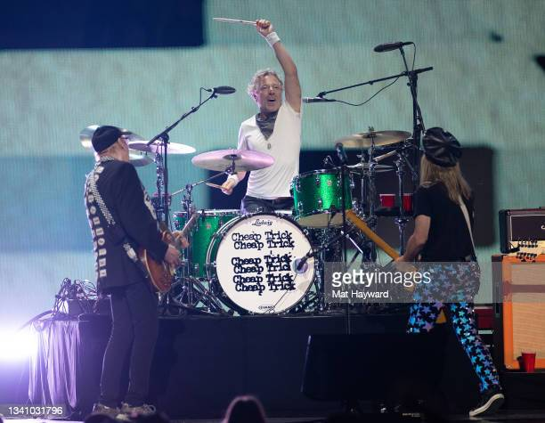 Daxx Nielsen, Rick Nielsen and Robin Zander of Cheap Trick perform on stage during the iHeartRadio Music Festival at T-Mobile Arena on September 17,...