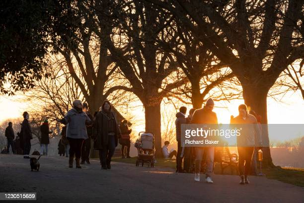 Day after London Mayor Sadiq Khan announced the spread of Covid is said to be out of control, South Londoners take their exercise in a cold Brockwell...