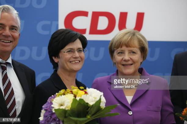 A day after the elections in Thuringia and Brandenburg presented the Chancellor Angela Merkel flowers to leading candidate Christine Lieberknecht...