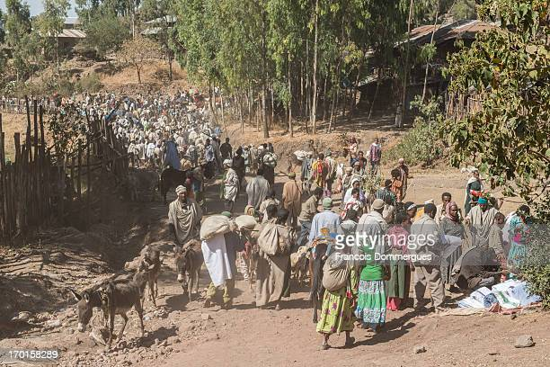 Day before Ethiopian Christmas eve , Lalibela fills up with pilgrims, some of which have traveled several hundred kilometers. Saturday is market day....