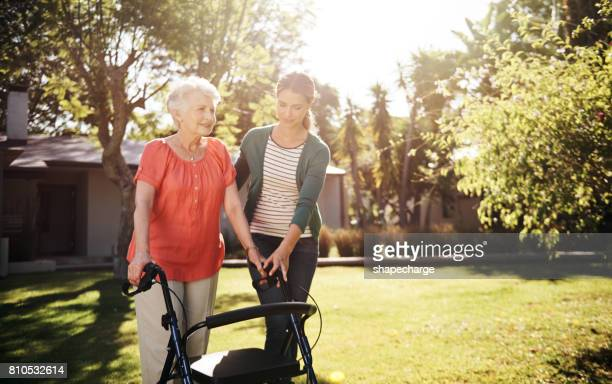 day by day, step by step - walker stock photos and pictures