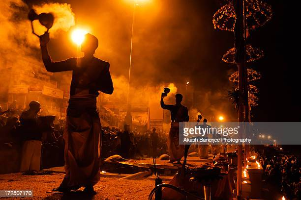 a day by the ganga - evening aarti on the ghat - varanasi stock pictures, royalty-free photos & images
