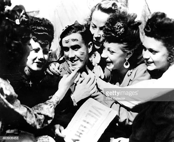 VE Day celebrations Paris 8 May 1945 A soldier smothere with kisses by jubilant women