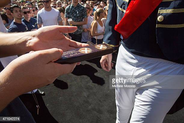 Day Crowds at the Australian Hotel Rocks to play two Up on April 25 2015 in Sydney Australia 2 Pennies are placed on a paddle and tossed in the air...