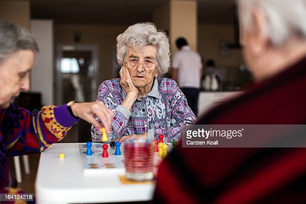 Day guests Hannelore and Helga play the game Ludo in the geriatric day care facility of the German Red Cross at Villa Albrecht on March 11 2013 in...