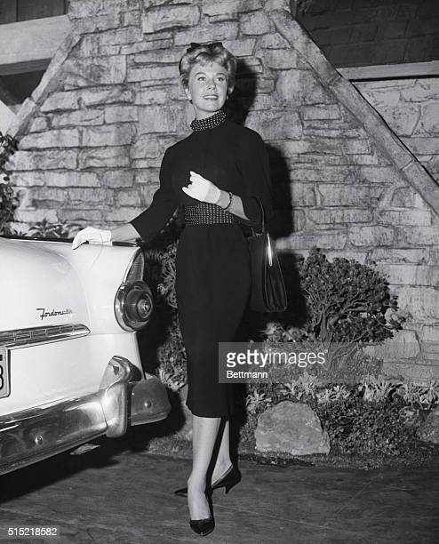 A Day in the Life of Doris Day This is the 'smart girl goes shopping look' Doris Day style Of lightweight black wool the skirt is slender and the...