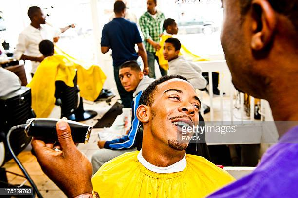 A day in the life of Faisal Barbers in Harlesden west London The barbers shop is run by Faisal Abdu' Allah [ purple top / blah in the event pix ] who...