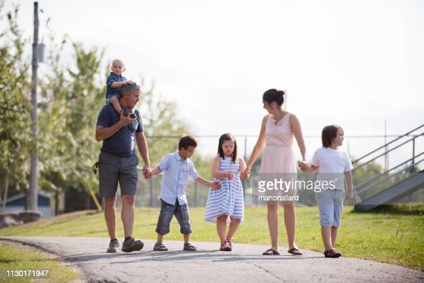 day in the life of family with four childs whom two are down's syndrome and autism - autism spectrum disorder stock photos and pictures