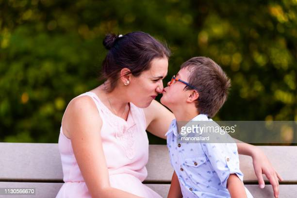 day in the life of family with four childs whom two are down's syndrome and autism - autismo foto e immagini stock