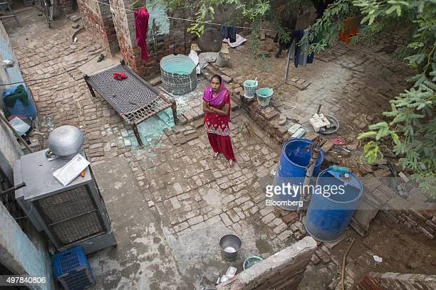 Day laborer Kamlesh stands for a portrait at her home in Lahli village Haryana India on Tuesday Nov 3 2015 After years of volunteering for a union in...
