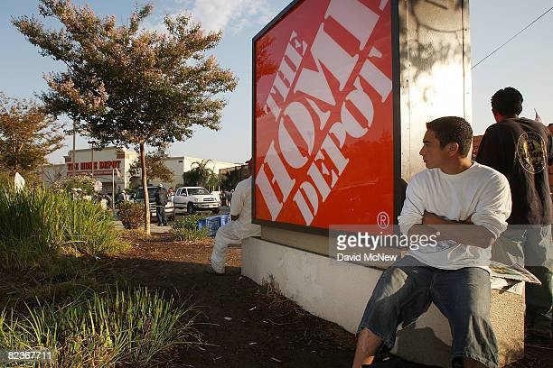 Day laborers wait near a Home Depot home improvement store in hope of finding work for the day on August 15 2008 in Los Angeles California The Los...