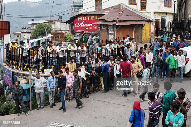 Day laborers wait to be hiired for work on the side of a road in Dharamsala India on Thursday June 9 2016 Consumer Price Index figures for May are...