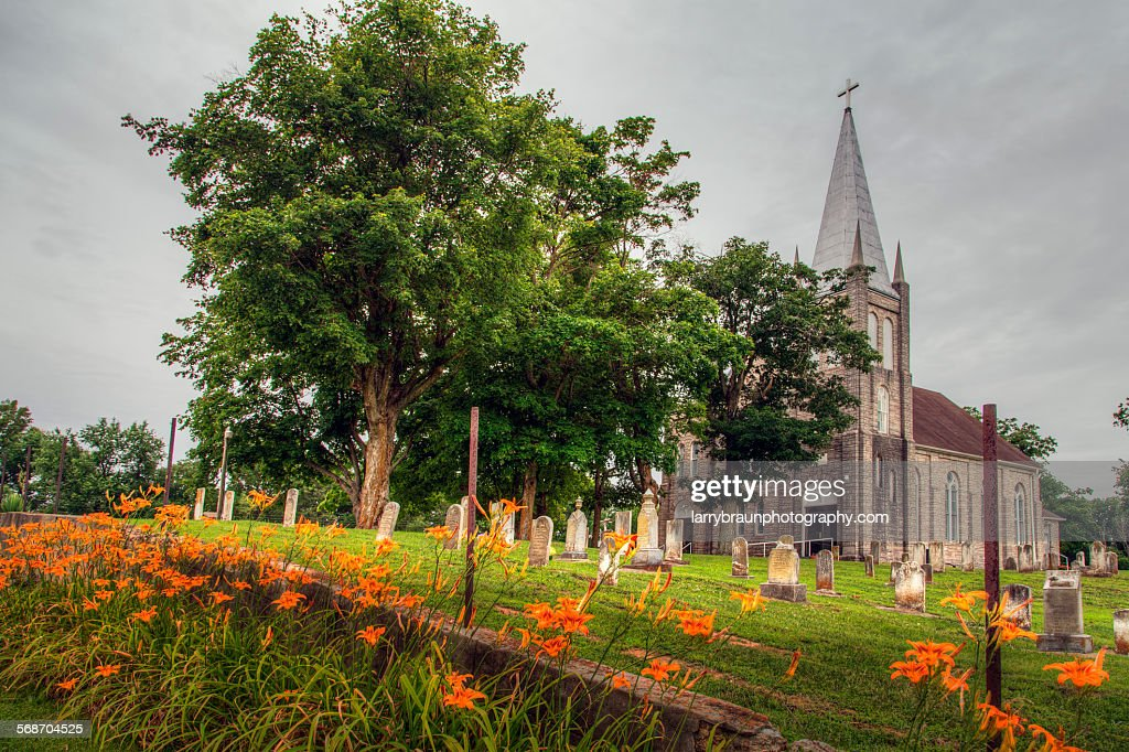 Day lilies by a Church : Stock Photo