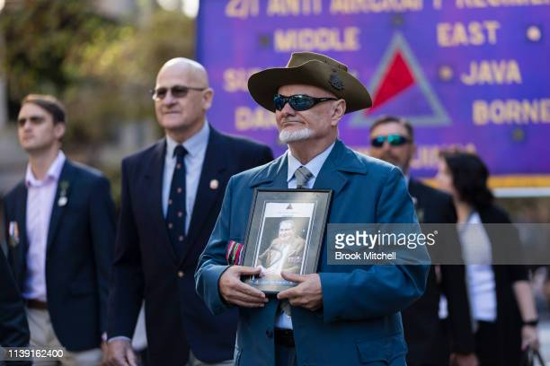 Day Marchers carry pictures of lost loved ones on April 25 2019 in Sydney Australia Australians commemorating 104 years since the Australian and New...