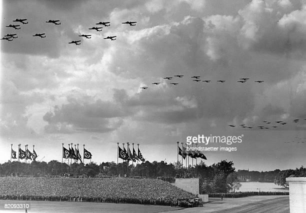 Day of the armed forces in Nuremberg Photograph Around 1935 [Tag der Wehrmacht in Nrnberg Flugzeugverbnde fliegen ber die Zeppelinwiese Photographie...