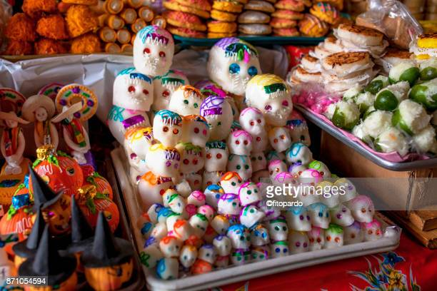 day of the dead candies and traditional sweets - sugar skull stock photos and pictures