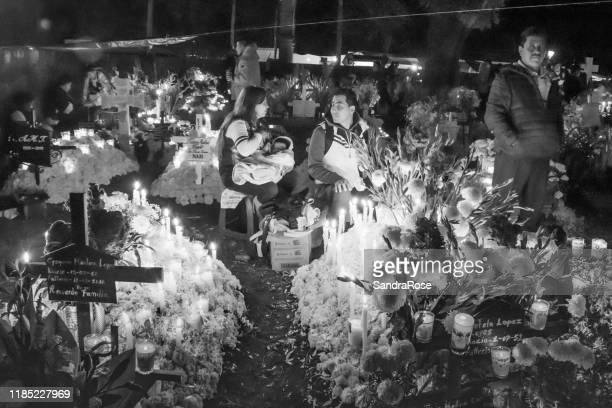 day of the dead cemetery michaocan mexico remberance by families of loved ones - religious vigil stock pictures, royalty-free photos & images