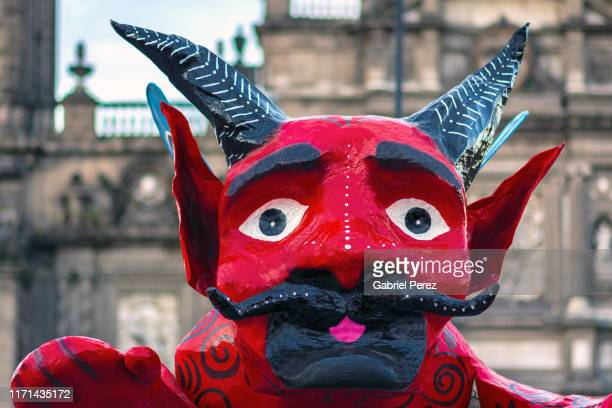a day of the dead character in mexico city - devil stock pictures, royalty-free photos & images