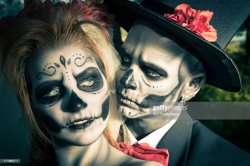 Day of the Dead couple in traditional costumes and makeup : Stock Photo