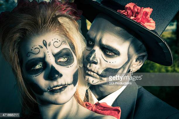 day of the dead couple in traditional costumes and makeup - zombie makeup stock photos and pictures