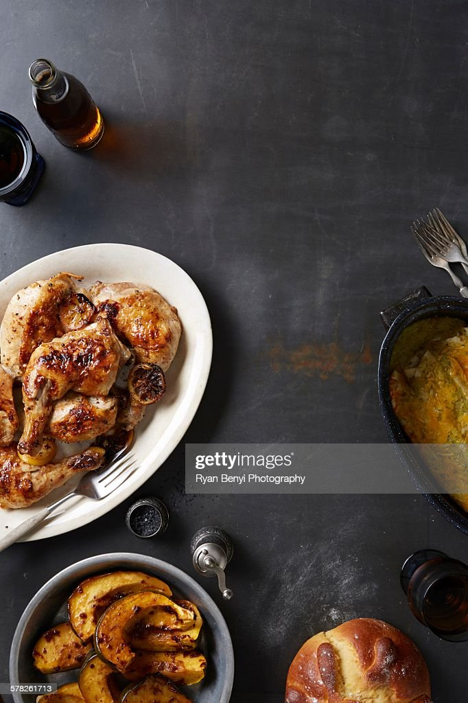 Day of the Dead food with roasted chicken and mole poblano sauce, acorn squash and enchiladas : Stock Photo