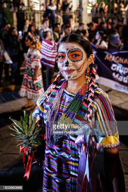 """day of the dead parade - women wearing traditional dresses walking on the parade - """"gerard puigmal"""" stock pictures, royalty-free photos & images"""