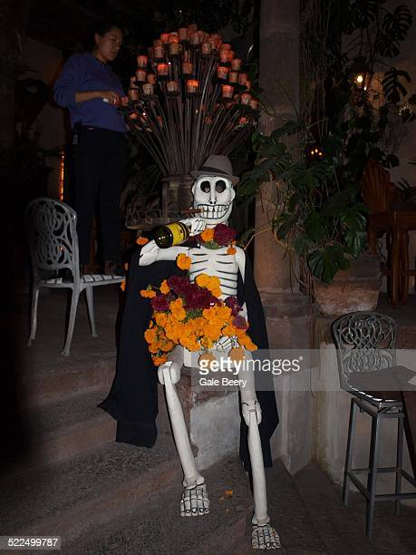 Day of the dead Skelton Drinking tequila with Marigolds day of the Dead flower