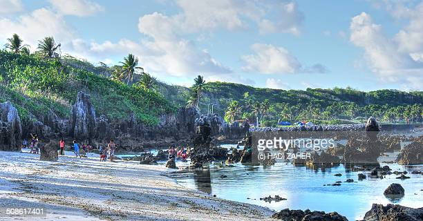 a day on a rocky beach | nauru - nauru stock pictures, royalty-free photos & images