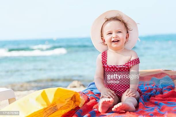 day on beach - sun hat stock pictures, royalty-free photos & images