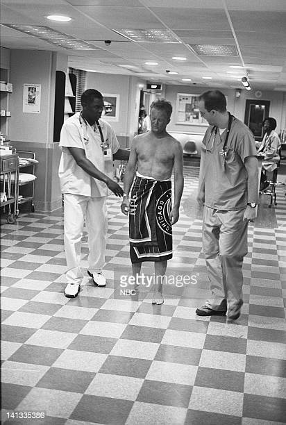 ER 'Day One' Episode 2 Air Date Pictured Deezer D as Nurse Malik McGrath Kristopher Logan as Lobster Man Anthony Edwards as Doctor Mark Greene Photo...