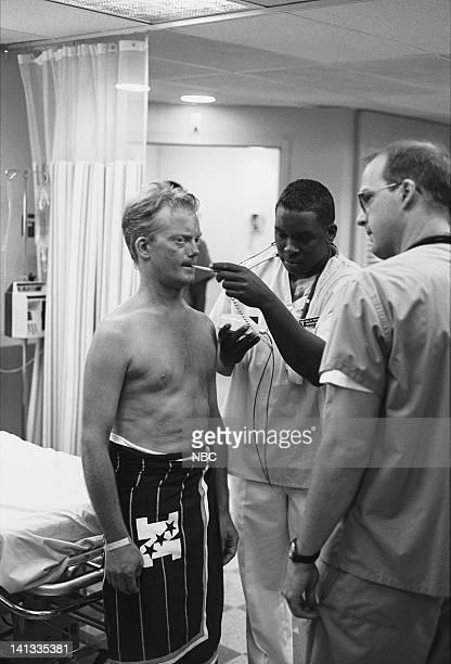 ER 'Day One' Episode 2 Air Date Pictured Kristopher Logan as Lobster Man Deezer D as Nurse Malik McGrath Anthony Edwards as Doctor Mark Greene Photo...