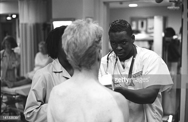 ER Day One Episode 2 Air Date Pictured Kristopher Logan as Lobster Man Deezer D as Nurse Malik McGrath Photo by Paul Drinkwater/NBCU Photo Bank